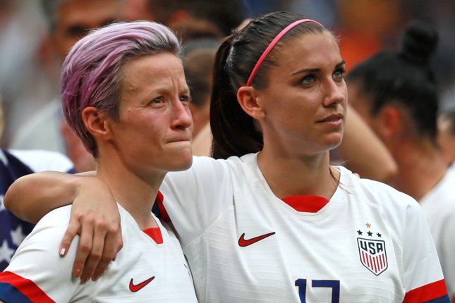 Megan Rapinoe (L) and Alex Morgan (R) are among the 72 players who seek to appeal Judge R. Gary Klausner's May 1 rejection of a claim that they have been underpaid compared to their counterparts on the men's team. FilePhoto by David Silpa/UPI