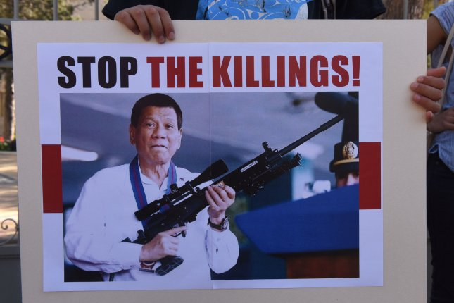 A demonstrator holds a sign condemning Philippines President Rodrigo Duterte during a rally in Jerusalem, Israel, on September 4, 2018. Duterte has been called a dictator who justifies acts of violence. File Photo by Debbie Hill/UPI