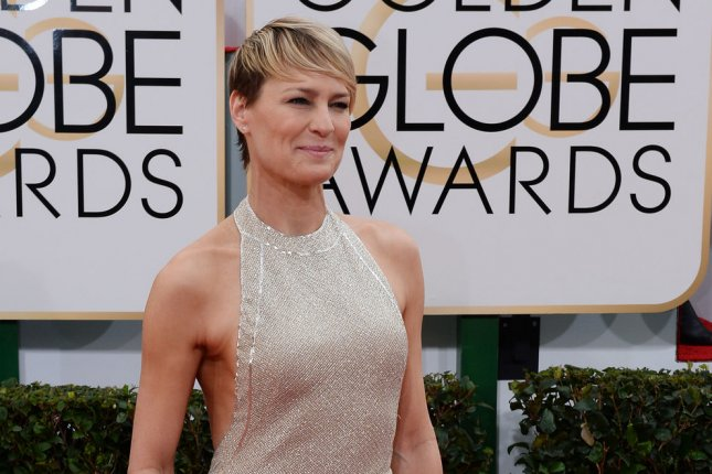 Actress Robin Wright arrives for the 71st annual Golden Globe Awards at the Beverly Hilton Hotel in Beverly Hills, California on January 12, 2014. UPI/Jim Ruymen