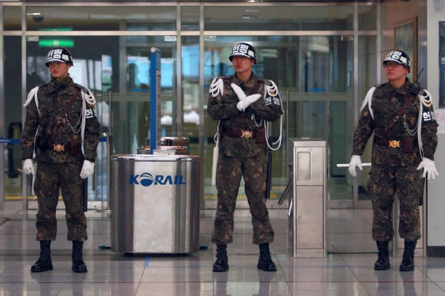 South Korean soldiers stand guard near the demilitarized zone. North Korea has closed a cross-border highway that has linked North and South since 2004. File Photo by Stephen Shaver/UPI