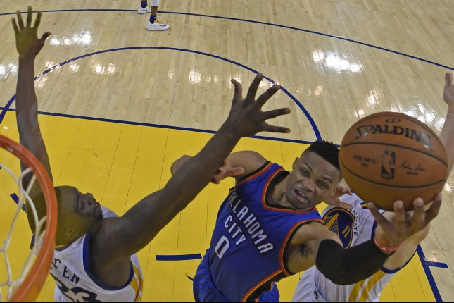 Oklahoma City Thunder's Russell Westbrook (0) goes up for a layup past Golden State WarriorsÕ Draymond Green (23) in the fourth quarter of Game 1 of the NBA Western Conference finals at Oracle Arena in Oakland, California on May 16, 2016. Oklahoma City defeated Golden State 108-102. Pool photo by Jose Carlos Fajardo/UPI