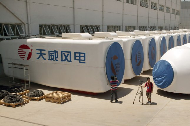 Parts of massive wind turbines sit outside a factory in China. A group of U.S. governors warns the White House it's China that will gain the economic advantages from a low-carbon world. Photo by Stephen Shaver/UPI.
