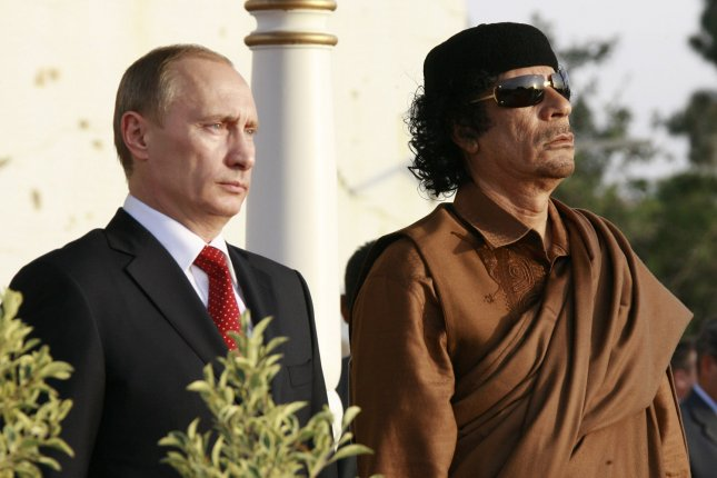 Libyan leader Moammar Gadhafi (R), shown here in 2008 with Russian President Vladimir Putin, for decades viewed WMD as a means of deterring foreign intervention. File Photo by Anatoli Zhdanov/UPI