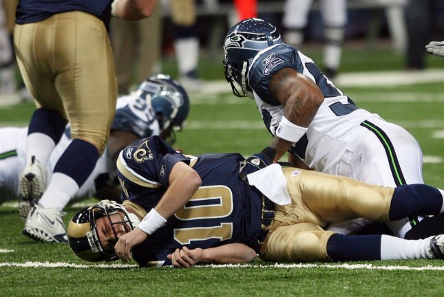 St. Louis Rams quarterback Marc Bulger lays on the turf after being sacked against the Seattle Seahawks in St. Louis on November 25, 2007. Bulger left the game with a concussion and was transported to an area hospital. Researchers are developing a so-called concussion pull that involves medical cannabis. Photo by Bill Greenblatt/UPI