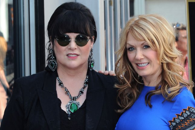 Heart members Ann Wilson (L) and Nancy Wilson. The band has announced a new tour that will feature guests such as Joan Jett and Sheryl Crow. File Photo by Jim Ruymen/UPI
