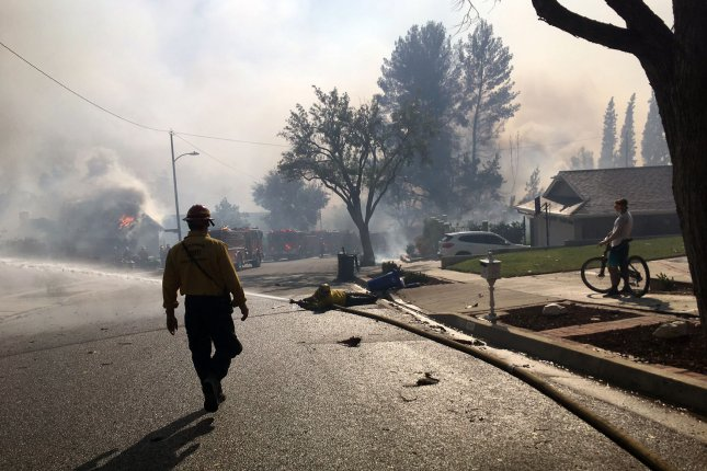Members of a Santa Barbara County Fire Department 8, in Calabasas, California, fighting the Woolsey Fire in Calabasas, Calif., on are pictured on November 9. Fire officials predict the upcoming wildfire season in the United States could be worse than last year.Photo courtesy Battalion Chief David Neels/Santa Barbara County Fire Department/UPI