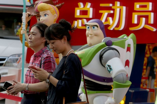 Shoppers visit a multimedia display showcasing the release of Toy Story 4 in Beijing on Friday. Photo By Stephen Shaver/UPI