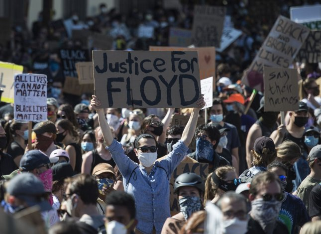 Protesters jam the streets during a demonstration in memory of George Floyd on 18th Street by Delores Park in San Francisco on Wednesday. Photo by Terry Schmitt/UPI