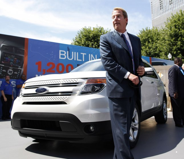 Bill Ford, Ford executive chairman, stands next to the all-new 2011 Explorer at an event in Millennium Park in Chicago on July 26, 2010. The redesigned SUV includes safety features such as inflatable seatbelts, and over 30 percent better fuel economy than the current model Explorer. UPI/Brian Kersey