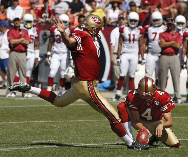 San Francisco 49ers kicker Joe Nedney (L) kicks a 39 yard field goal from the hold of Andy Lee (4) against the Arizona Cardinals at Candlestick Park in San Francisco on September 7, 2008. The Cardinals defeated the 49ers 23-13. (UPI Photo/Terry Schmitt)
