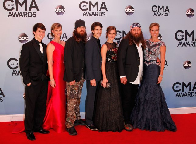 Members of the reality television show Duck Dynasty arrive on the red carpet at the 47th Annual Country Music Awards at the Bridgestone Arena in Nashville, November 6, 2013. UPI/Terry Wyatt