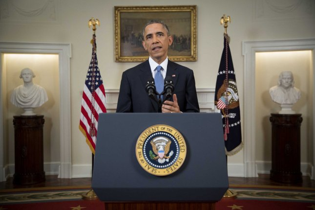 President Barack Obama delivers an address announcing that the U.S. will work with Cuba to normalize diplomatic ties in the Cabinet Room of the White House, Dec. 17, 2014. UPI/Doug Mills/Pool