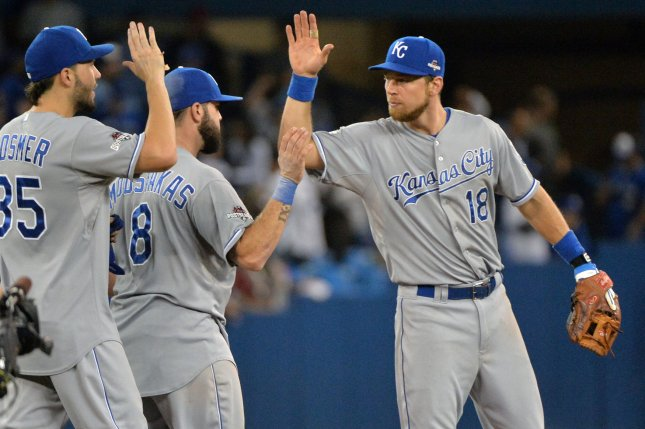 Kansas City Royals Eric Hosmer (L), Jose Bautista, and Ben Zobrist (18) high five each other after defeating the Toronto Blue Jays in the ALCS game 4 at the Rogers Centre in Toronto, Canada on October 20, 2015. Kansas City beat Toronto 14-2 to take a 3-1 series lead. Photo by Kevin Dietsch/UPI