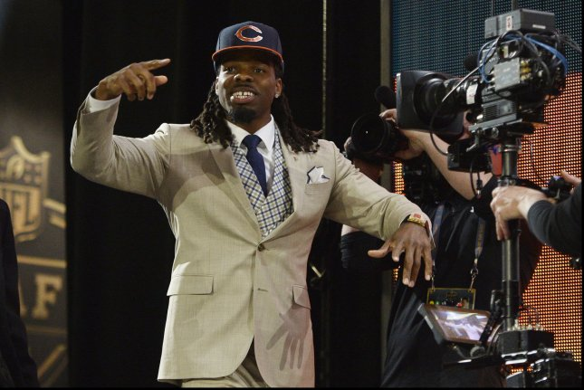 West Virginia's Kevin White walks out onto the stage after he was selected with the seventh overall pick by the Chicago Bears during the first round of the NFL Draft on April 30, 2015 in Chicago. Photo by Brian Kersey/UPI
