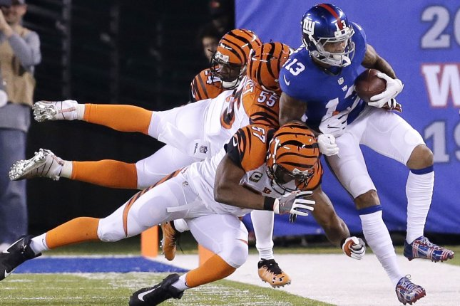 Cincinnati Bengals Vincent Ray snd Vontaze Burfict force New York Giants Odell Beckham Jr. out of bounds in the first half in week 10 of the NFL at MetLife Stadium in East Rutherford, New Jersey on November 14, 2016. Photo by John Angelillo/UPI