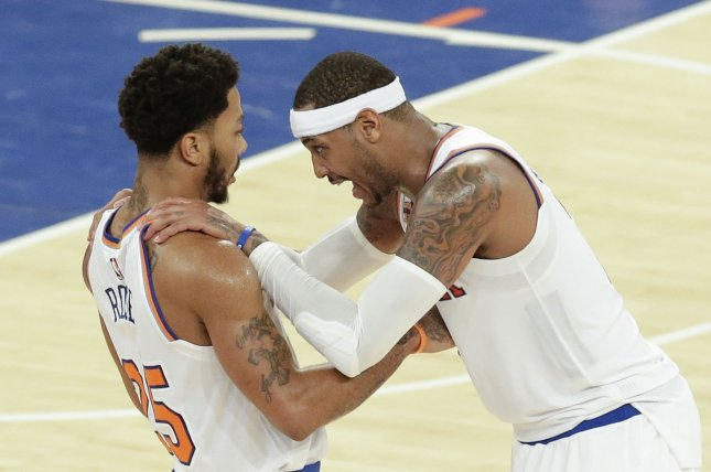 New York Knicks Carmelo Anthony reacts with Derrick Rose after Rose hits a a 3-point shot in the 4th quarter at Madison Square Garden in New York City on November 25, 2016. Photo by John Angelillo/UPI