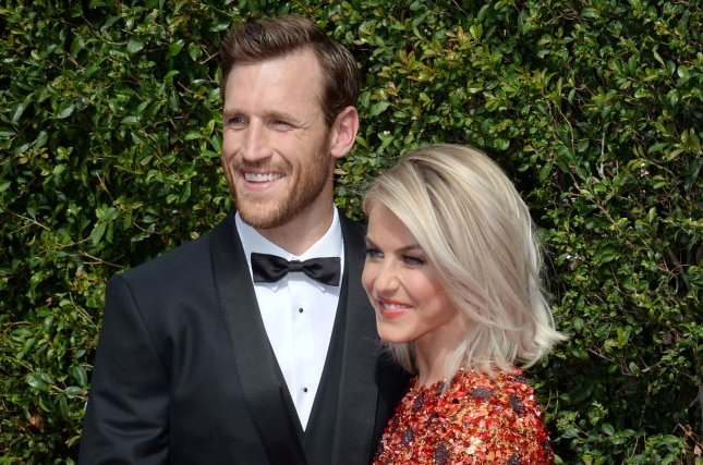 Julianne Hough (R) and Brooks Laich attend the Creative Arts Emmy Awards on September 12, 2015. The couple shared 1950s-inspired pictures from their honeymoon this week. File Photo by Jim Ruymen/UPI