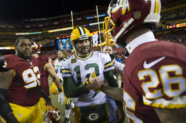 Green Bay Packers quarterback Aaron Rodgers (12) is congratulated by former Washington Redskins cornerback Bashaud Breeland (26) after the Packers defeated the Redskins 35-18 in an NFC Wild Card game at FedEx Field in Landover, Md. File photo by Kevin Dietsch/UPI