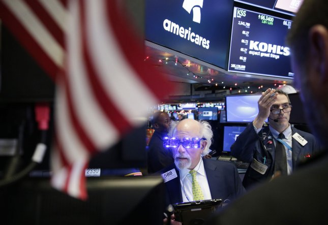 Traders wear 2019 glasses when they work on the floor of the NYSE at the closing bell on the last day of trading for 2018 at the New York Stock Exchange on Wall Street in New York City. Stocks closed Monday with modest gains, but experienced their worst year in a decade overall. Photo by John Angelillo/UPI