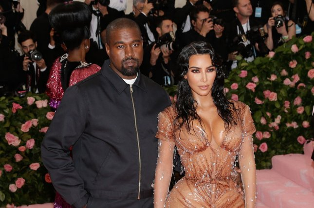 Kim Kardashian (R) and Kanye West showed their private vow renewal ceremony on Keeping Up with the Kardashians. File Photo by John Angelillo/UPI