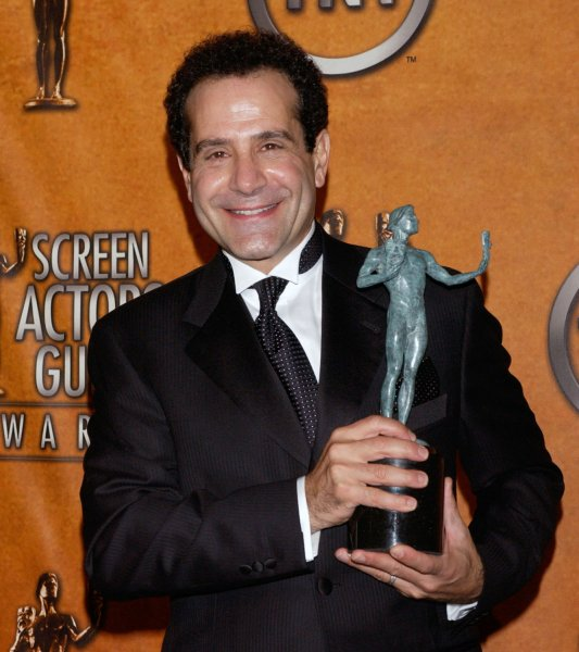 Tony Shaloub holds his award for outstanding performance by a male actor in a comedy series for his work in Monk, backstage during the 11th annual Screen Actors Guild Awards at the Shrine Auditorium in Los Angeles, February 5, 2005. (UPI Photo/Jim Ruymen)