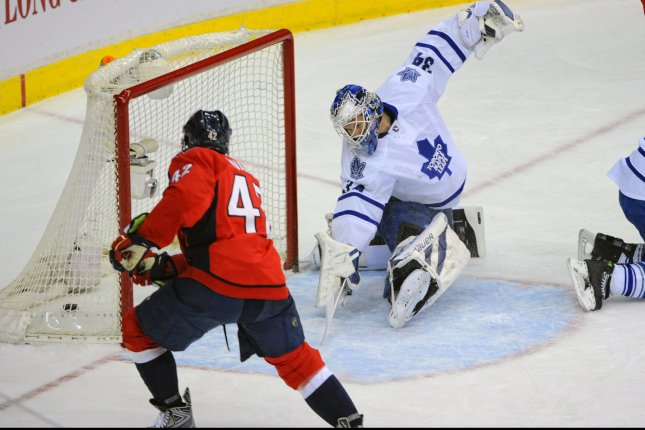 Washington Capitals right wing Joel Ward (42) scores against Toronto Maple Leafs goalie James Reimer (34) in the first period at the Verizon Center in Washington, D.C. on March 16, 2014. UPI/Mark Goldman