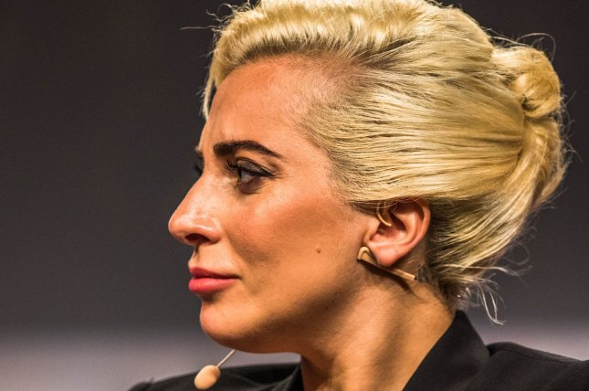 The Dalai Lama (not shown) and Lady Gaga discuss issues at a forum during the 84th Annual Meeting of the United States Conference of Mayors on June 26, 2016 in Indianapolis. Photo by Edwin Locke/UPI