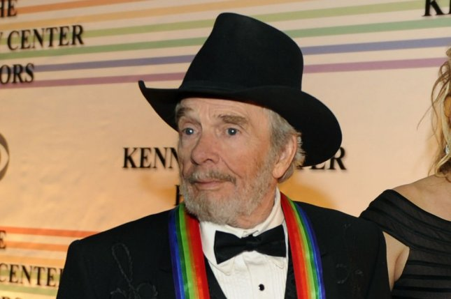 Country Western singer and songwriter Merle Haggard, a 2010 Kennedy Center Honoree, walks past photographers at the Kennedy Center on December 5, 2010. Following his death in April, the Academy of Country Music has created the Merle Haggard Spirit Award which country singer Sturgill Simpson has spoken out against on social media. File Photo by Mike Theiler/UPI