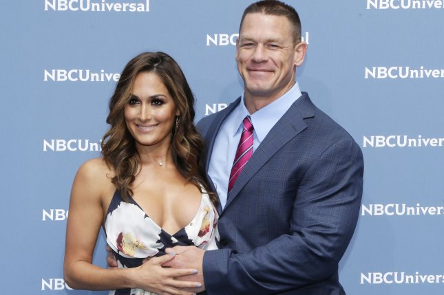 Nikki Bella (L) and John Cena arrive at the 2016 NBCUNIVERSAL Upfront on May 16, 2016 in New York City. The couple got engaged at WrestleMania in Orlando, Fla., Sunday night. File Photo by John Angelillo/UPI