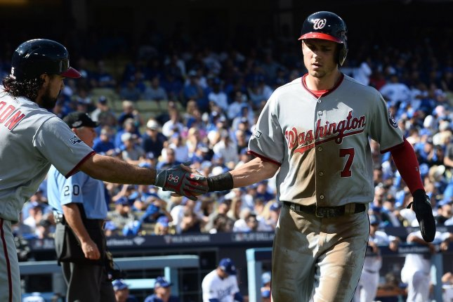 Washington Nationals' Trea Turner (7) is congratulated by teammate Anthony Rendon. File photo by Jim Ruymen/UPI
