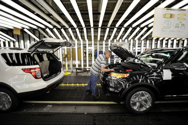 A worker inspects a Ford sport-utility vehicle as it rolls off the line at the automaker's assembly plant in Chicago, Ill. File Photo by Brian Kersey/UPI