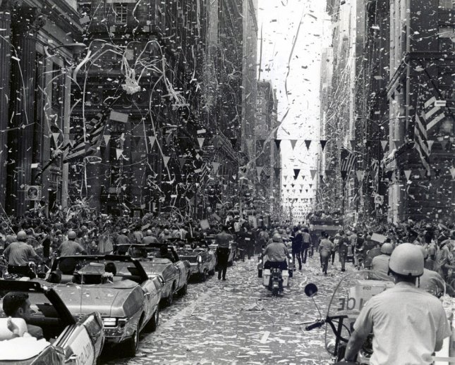 Confetti and streamers fill the street as the City of Chicago welcomes the three Apollo 11 astronauts, Neil A. Armstrong, Michael Collins, and Buzz Aldrin, Jr. on August 13, 1969. File photo by UPI