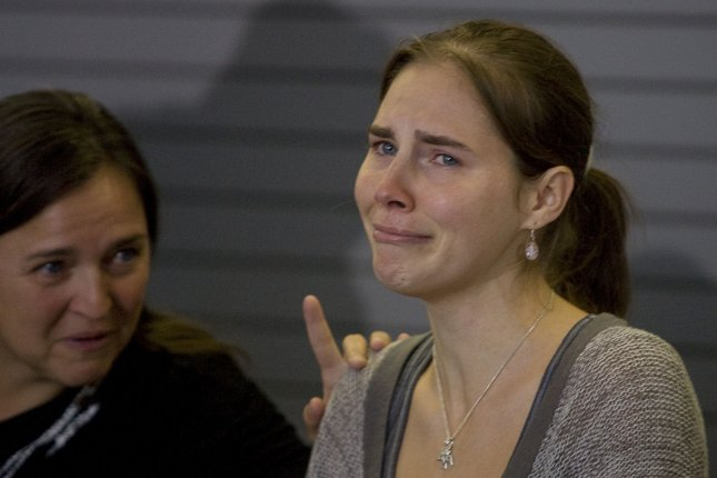 Amanda Knox appears during a news conference held at Seattle-Tacoma International Airport on October 4, 2011. On December 4, 2009, an Italian jury found Knox and her Italian boyfriend, Raffaele Sollecito, guilty of murdering her roommate. File Photo by Jim Bryant/UPI