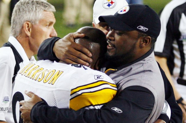 Former Pittsburgh Steelers linebacker James Harrison (L) said he received the envelope from head coach Mike Tomlin (R) after a hit on Cleveland Browns wide receiver Mohamed Massaquoi in 2010. File Photo by John Angelillo/UPI