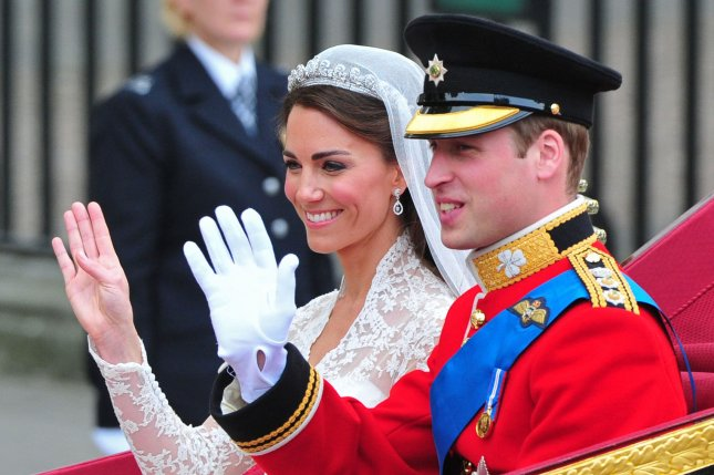 Prince William and Kate Middleton, duchess of Cambridge, wave as they leave Westminster Abbey in a carriage following their wedding ceremony in London on April 29, 2011. File Photo by Kevin Dietsch/UPI