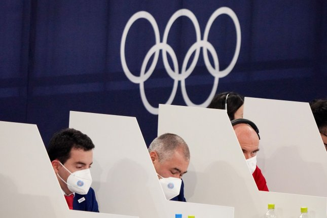Olympic judges wear face masks and are separated by barriers to comply with COVID-19 restrictions during men's gymnastics preliminary competition at Ariake Gymnastics Center in Tokyo on Saturday Photo by Richard Ellis/UPI.
