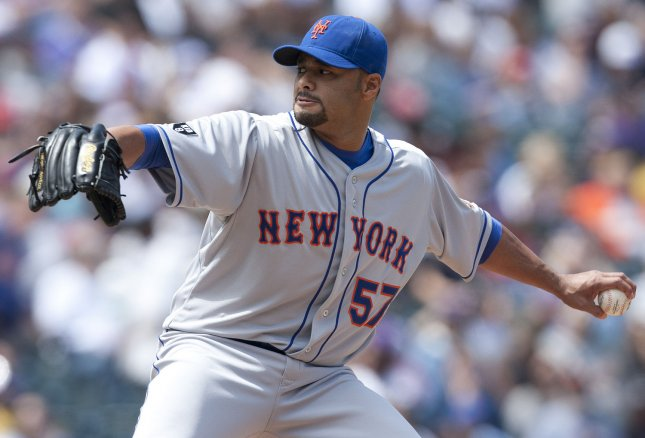 New York Mets starter Johan Santana, hobbled by a sore back, is done for the season, club General Manager Sandy Alderson said Wednesday. April 29 file photo. UPI/Gary C. Caskey