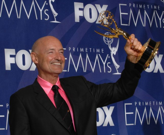 Terry O'Quinn holds his Emmy for work on 'Lost at the 59th Primetime Emmy Awards at the Shrine Auditorium in Los Angeles on September 16, 2007. (UPI Photo/Scott Harms)