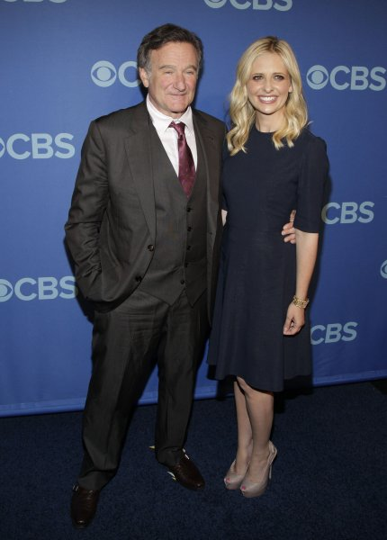 Robin Williams and Sarah Michelle Gellar arrive on the red carpet at the 2013 CBS Upfront Presentation at Lincoln Center in New York City on May 15, 2013. UPI/John Angelillo