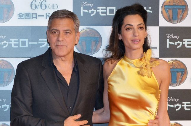 Amal Clooney (R) with husband George Clooney at the Tokyo premiere of 'Tomorrowland' on May 25, 2015. Photo by Keizo Mori/UPI