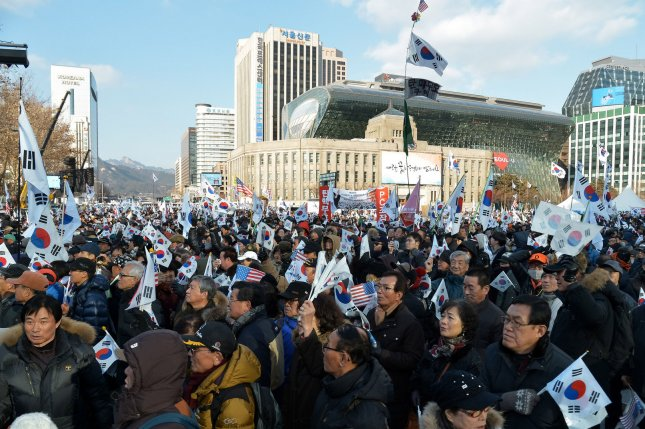 Supporters of President Park Geun-hye march opposing her impeachment near Seoul City Hall on Feb. 11. A South Korean presidential candidate who has supported her impeachment says informants in the government should receive better protection. Photo by Keizo Mori/UPI