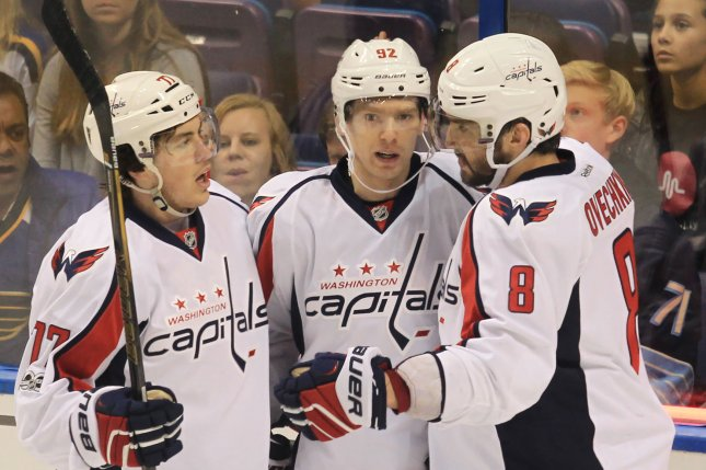 Washington Capitals T.J. Oshie (L) and Alex Ovechkin of Russia (R) congratulate Evgeny Kuznetsov of Russia on his goal in the third period against the St. Louis Blues at the Scottrade Center in St. Louis on Janauary 19, 2017. The goal was the Capitals seventh of the game. Photo by Bill Greenblatt/UPI
