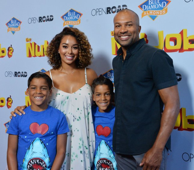 Former NBA player Derek Fisher and TV personality Gloria Govan attend the premiere of The Nut Job 2: Nutty by Nature with Govan's twin sons Isaiah Michael Barnes (L) and Carter Kelly Barnes in Los Angeles on August 5. File Photo by Jim Ruymen/UPI