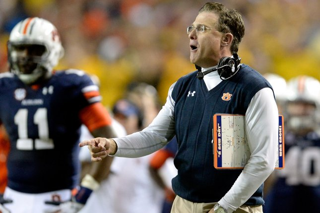 Auburn head coach Gus Malzahn shouts to a referee during the 2013 SEC Championship game vs. Missouri. File photo by David Tulis/UPI