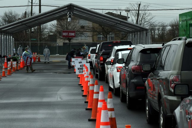 Vehicles line up at a drive-through coronavirus testing center on Staten Island, New York, on March 19. Photo by Maj. Patrick Cordova/U.S. Air National Guard/UPI