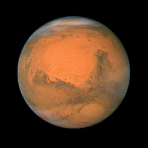 NASA's Hubble Space Telescope took this close-up of the red planet Mars when it was just 55 million miles (88 million kilometers) away on December 17, 2007. Mars will be at its brightest on December 24, 2007 as it aligns directly opposite of the sun, and will not be as visible for another nine years. This color image was assembled from a series of exposures taken within 36 hours of the Mars closest approach with Hubble's Wide Field and Planetary Camera 2. (UPI Photo/NASA/ESA/Hubble Heritage Team)