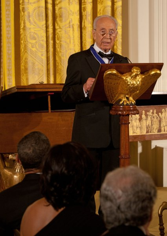 Israeli President Shimon Peres speaks during a dinner in Washington June 13, 2012. UPI/Martin H. Simon