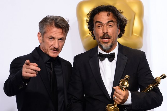 Sean Penn (L) made a green card joke about friend and director Alejandro Gonzalez Inarritu at the 87th Academy Awards. Photo by Jim Ruymen/UPI