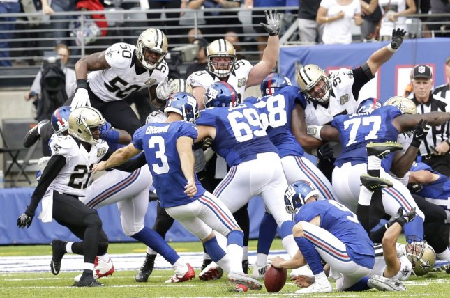 Former New York Giants kicker Josh Brown kicks a game winning field goal in the 4th quarter against the New Orleans Saints in week 2 of the NFL at MetLife Stadium in East Rutherford, New Jersey on September 18, 2016. The Giants defeated the Saints 16-13. Photo by John Angelillo/UPI