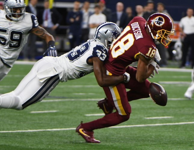 Washington Redskins receiver Josh Doctson tries to escape the grasp of Dallas Cowboys defender Chidobe Awuzie during their game at AT&T Stadium in Arlington, Texas on November 30, 2017. Photo by Ian Halperin/UPI